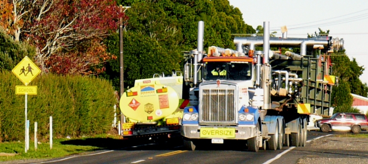 Oversized trucks on Inland North Road near Tikorangi school (photo by Fiona Clark, June 2013)